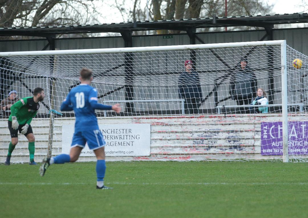 Stuart Fleetwood's shot hits the net