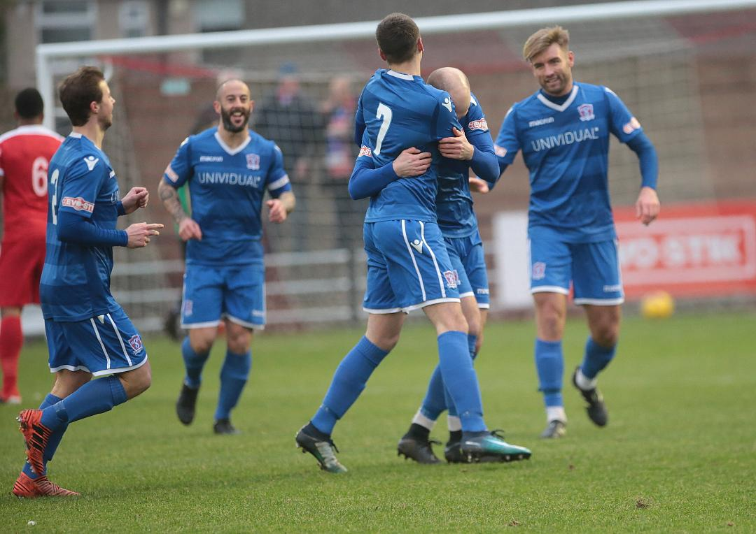 Another celebration after Henry Spalding's goal