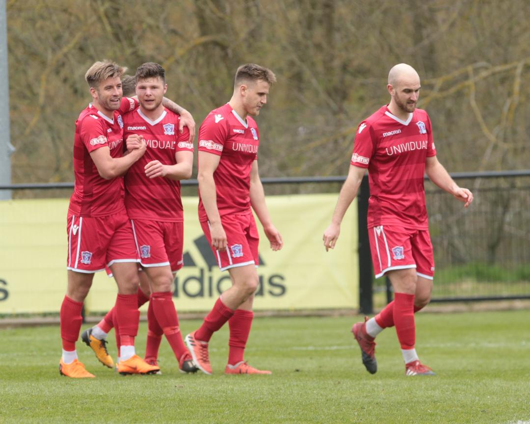 The players celebrate after Mat Liddiard scored our second goal