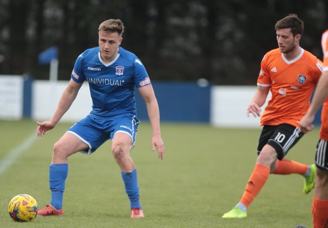 Calvin Dinsley in action against Met Police last April returns to the squad after his loan spell at Evesham United