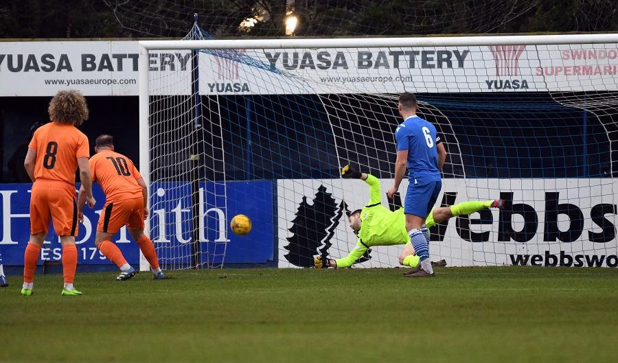 Sam Argent's (10) early header looks as though its in but Marine keeper Martin Horsell pulled off an excellent save