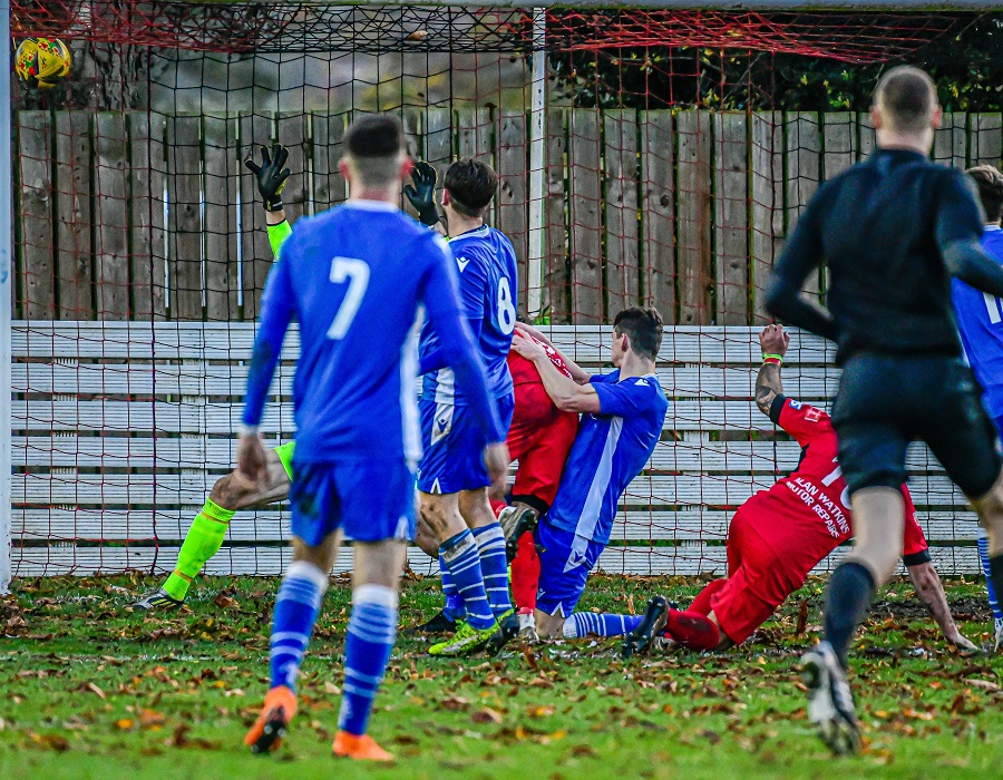 Another shot of Callum Parsons scoring Highworth's second goal